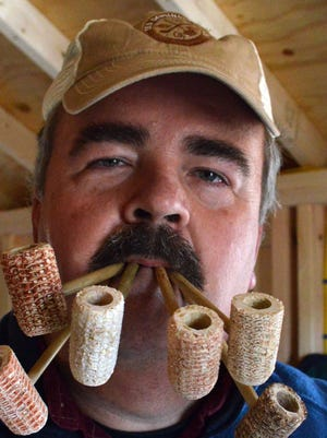 Bob Savage, co-owner of the Old Dominion Pipe Co., shows colored corncobs from a heritage corn variety that make each pipe the company makes unique.