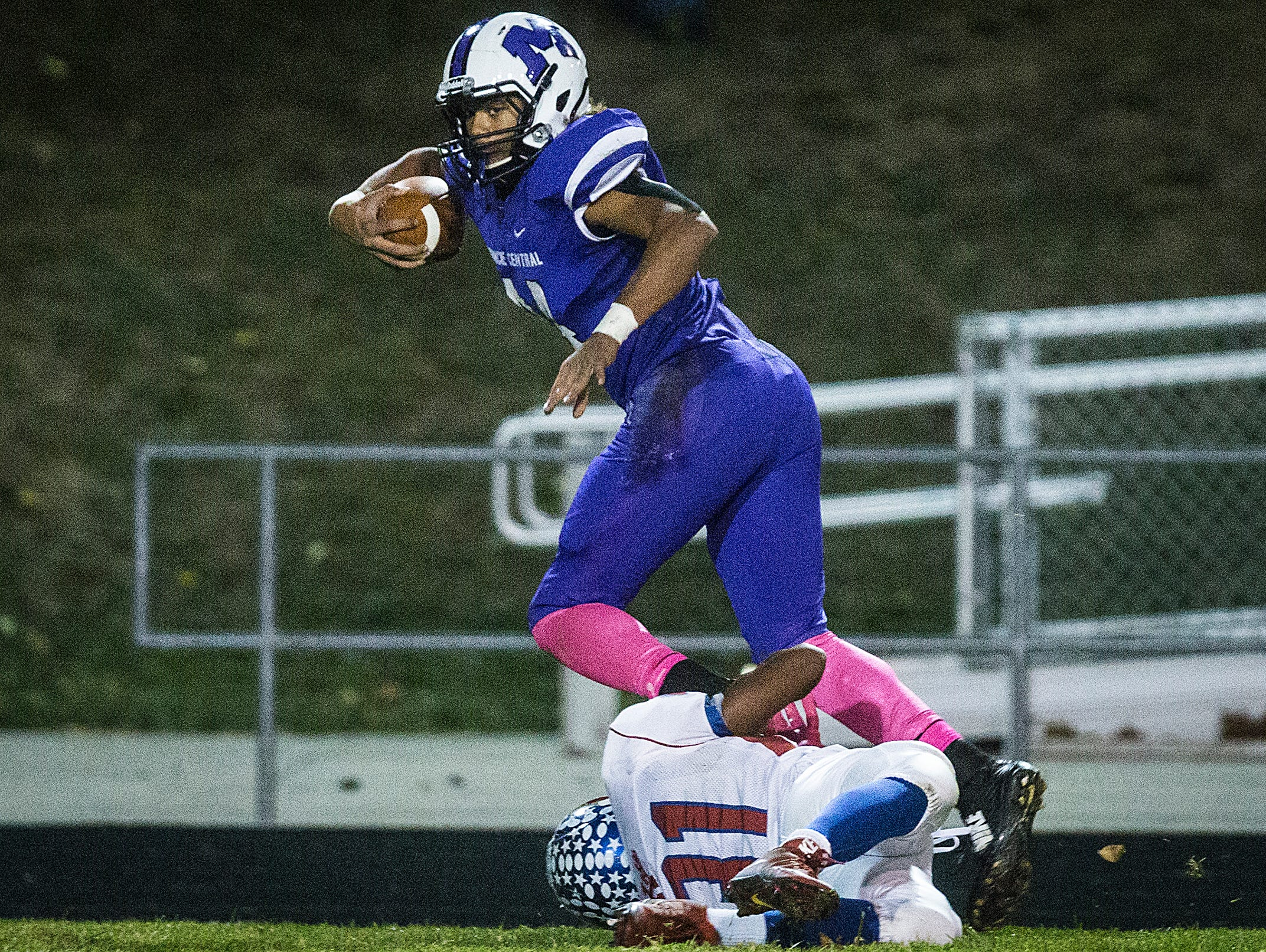 Central's Andre Wells fights past Kokomo's defense during their game at Central Friday, Oct. 30, 2015.