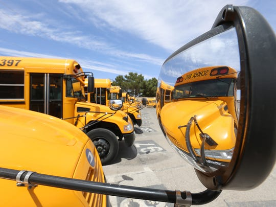 Buses are lined up, ready to shuttle children from