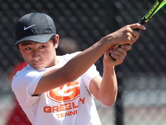 Horace Greeley's Kenta Toga competes boys tennis doubles finals at White Plains High School in White Plains on Thursday, May 24, 2018.