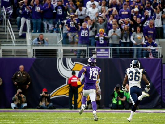 Minnesota Vikings wide receiver Adam Thielen (19) runs from Los Angeles Rams defensive back Dominique Hatfield, right, during a 65-yard touchdown reception in the second half of an NFL football game, Sunday, Nov. 19, 2017, in Minneapolis. (AP Photo/Bruce Kluckhohn)