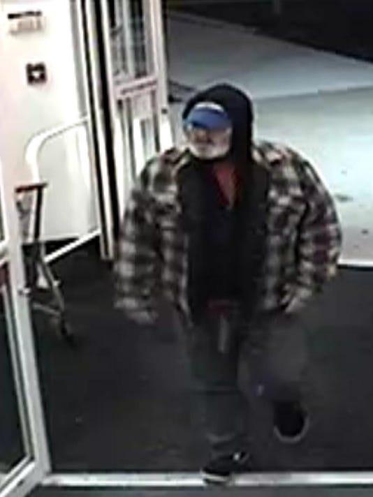 manchester police man showed gun during cvs robbery
