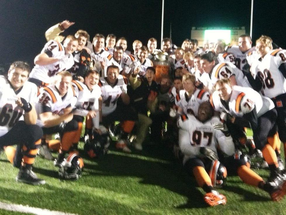 Northville players celebrate after earning a 35-25 victory over host Novi.