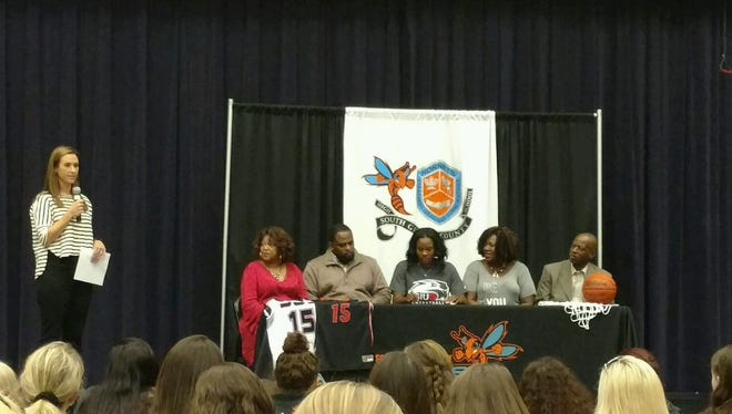 South Gibson's Christen King signs with SIU-Edwardsville on Monday.