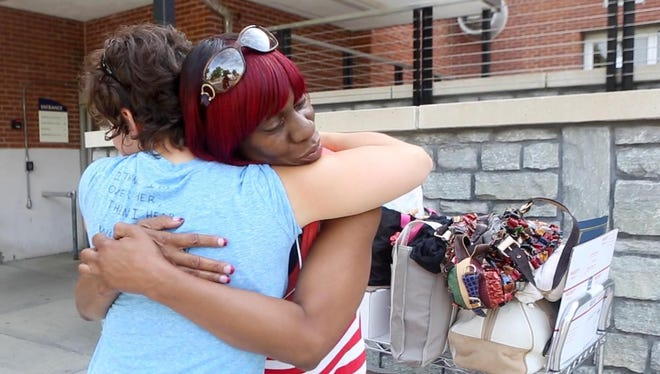 Erica Slone and Bea Myers hug as they say their goodbyes after completing a seven-week residential treatment program for PTSD at the Ft. Thomas Division of the Cincinnati VA Medical Center.