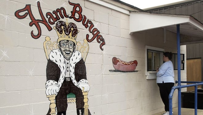 """Hamburger King on Decatur Street is the latest target of tele-scammers claiming to be Alabama Power, and owner Gay Harrison said she was """"one minute"""" away from falling for it Monday."""