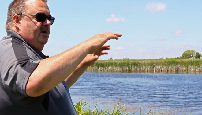 Two Rivers native and landowner Paul Becker shows off his restored wetland.