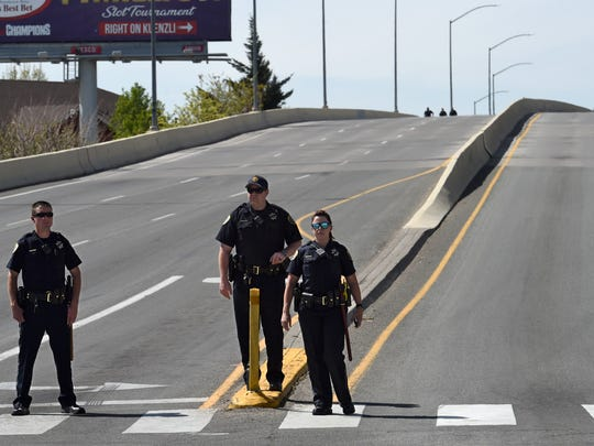 Reno police block the end of Wells Avenue overpass after a man was found sitting on the edge of the bridge Friday morning on May 4, 2018.