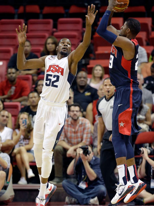 Oklahoma City Thunder's Kevin Durant (52) guards Indiana Pacers' Paul George during the USA Basketball Showcase game Friday, Aug. 1, 2014, in Las Vegas. (AP Photo/John Locher)