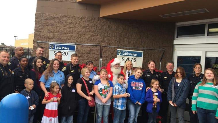 Lake City Police took children shopping for Christmas.