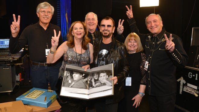 Musician Ringo Starr meets backstage on November 22, 2013 in Las Vegas, NV with the subjects of a photograph he took of six teens in a car during The Beatles' first U.S. visit in February 1964.  The five surviving teens (now in their sixties) attended the Ringo Starr concert and met with the former Beatle backstage after the show.  Pictured (l-r): Gary Van Deursen, Arlene Norbe, Bob Toth, Ringo Starr, Suzanne Rayot and Charlie Schwartz.