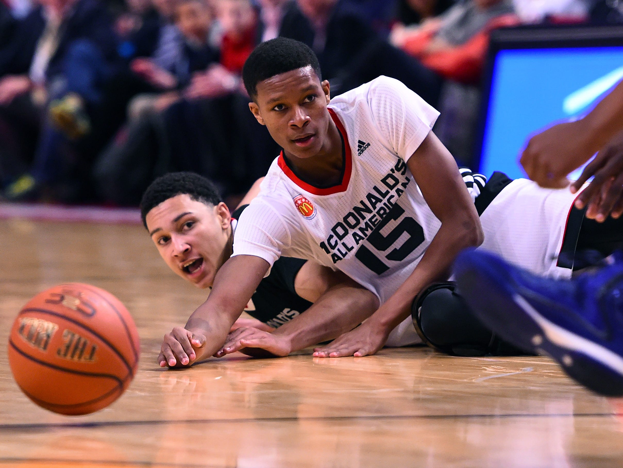 Apr 1, 2015; Chicago, IL, USA; McDonald's All American West guard PJ Dozier (15) dives for a loose ball against the McDonald's All American East during the second half at the United Center. Mandatory Credit: Mike DiNovo-USA TODAY Sports