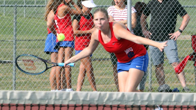Maggie Smith, who recently emerged into playing Moberly's No. 1 singles position, concentrates as she lunges forward to make a return during a home tennis match. The Lady Spartan netters picked up wins against Kirksville at home on Monday and about 24 hours later Moberly returned home from Columbia securing a 5-4 victory against Father Tolton Regional Catholic High School.