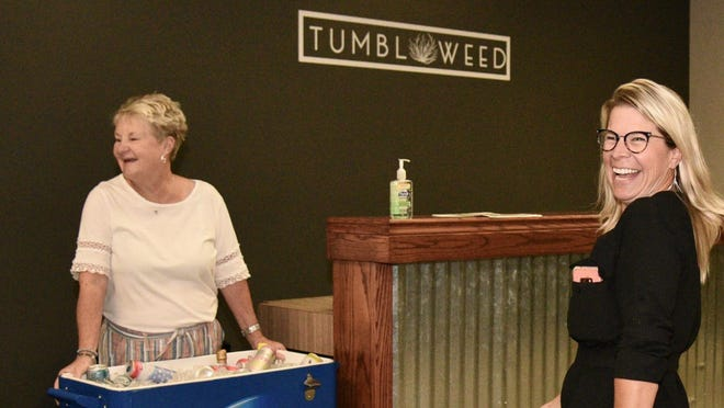 Jenni Jones, right, co-owner of Tumblweed Event Venue & Storage, laughs with Susan Weems during the open house for the event venue on Thursday evening.  The venue is located at 5680 W. Old Highway 40.