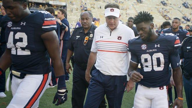 Auburn head coach Gus Malzahn talks to wide receiver Marcus Davis after their 45-21 loss.