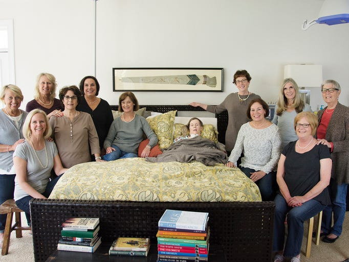 The calendar models and classmates gather at the bedside