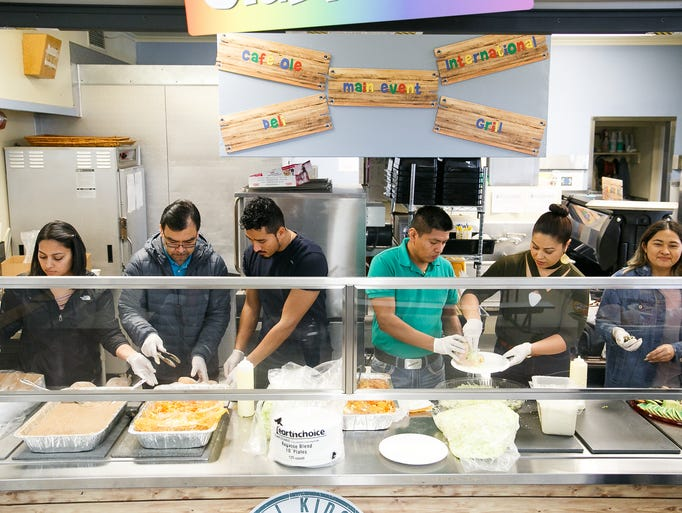 Friends and employees of La Margarita serve up food