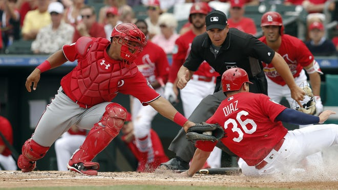 The Cardinals' Aledmys Diaz (36) beats the tag from Nationals catcher Pedro Severino (29) as he scores on a Matt Adams sacrifice fly in a spring training game on March 8 in Jupiter, Fla.