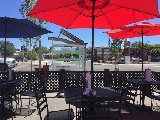 The dining terrace at Bada Bing's in Midtown Reno features red and blue umbrellas and front row seats for the Midtown floor show.