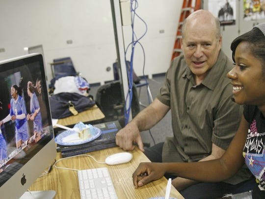 Former Disney executive David Vogel (left), works with Nailah Johnson during class at Cathedral City High School's Digital Arts Technology Academy in 2009.
