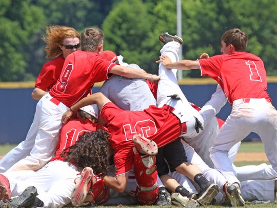 Riverheads' baseball team celebrates following their win at the Virginia High School League Class 1 state championship at Radford University in Radford on Saturday, June 9, 2018.