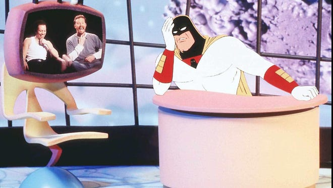 """Space Ghost interviews Metallica on the Cartoon Network program """"Space Ghost: Coast to Coast."""" Space Ghost was voiced by George Lowe."""