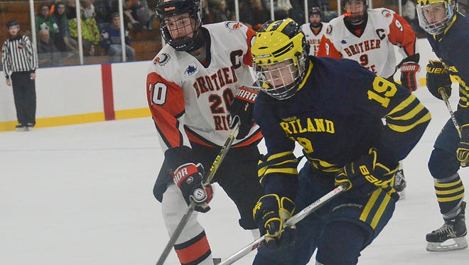 Blake Heier (19) and his Hartland teammates hope for a better result against Jack Clement (20) and Birmingham Brother Rice in the state semifinals Thursday.