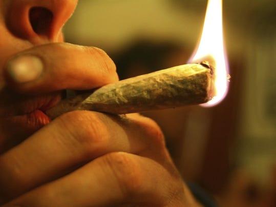An up close image of a person smoking marijuana