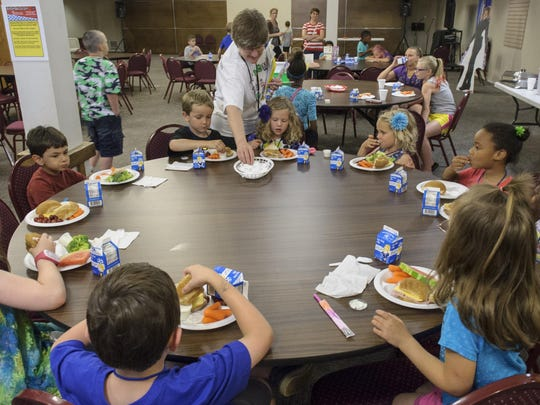 Polly Antonelli gives kids advice on fresh foods during Kids Cafe, the only USDA Summer Food Service Program that serves children within the Southeast Polk Community.