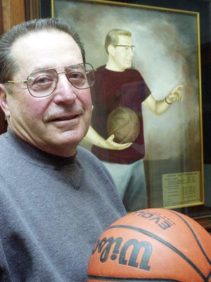 Former Vineland basketball coach Irv Gosman stands next to his portrait outside of the high school gym in 2002. Gosman passed away last Thursday.