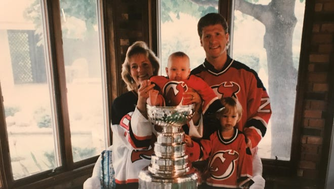 New Michigan State hockey coach Danton Cole poses with the Stanley Cup in 1995 next to his wife Debbie and young daughters Ashton, right, and Maddie, perched in the Cup, during the family's day with the Stanley Cup after Danton helped the New Jersey Devils beat the Red Wings in the Cup Finals.