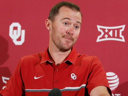 Oklahoma head coach Lincoln Riley listens to a question during an NCAA college football news conference in Norman, Okla., Monday, Aug. 28, 2017. The seventh-ranked Sooners will get their first test Saturday against Texas-El Paso. (AP Photo/Sue Ogrocki)