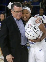 MTSU women's coach Rick Insell gives player Ty Petty