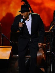 Aaron Neville performs on stage at the 2015 MusiCares