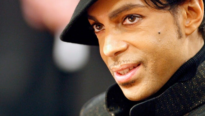 Prince takes in the NBA All-Star game Feb. 18,2007, in Las Vegas. Prince's representatives have confirmed that the iconic singer died April 21, 2016, at his Paisley Park residence in Minnesota,