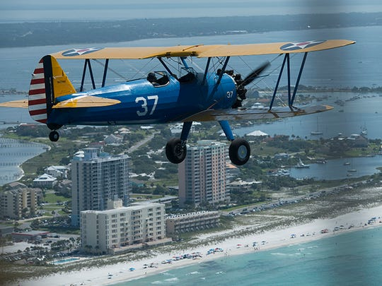 A collection of World War II era Stearman airplanes take to the skies over Pensacola for Veterans Flight 2015. Volunteer pilots gave a group of WWII veterans a flight over Pensacola Beach before the air show.