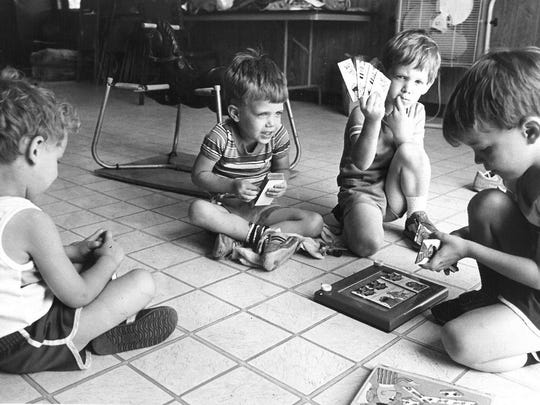 Keeping busy in the Camp Fire Council of North Texas' summer camp Papoose Unit, for 3- to 5-year-olds, from left, are John Folsom, Nathan Folsom, Kelly Mansfield. This photo was printed in the June 9, 1984, edition of the Wichita Falls Record News.;