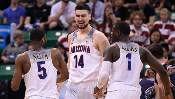 Arizona Wildcats center Dusan Ristic (14) reacts with