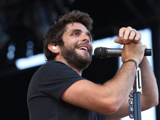 """Thomas Rhett performs at Vanderbilt Stadium on July 11, 2015. """"Die a Happy Man"""" and """"Crash and Burn"""" are among some of his hits."""