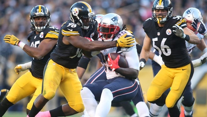 Pittsburgh Steelers inside linebacker Vince Williams (98) tackles New England Patriots running back LeGarrette Blount (29) during the second quarter at Heinz Field.