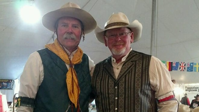 """William Baker, left, a New Mexico State University athletics team physician, aka """"Doc Baker,"""" and a friend, Michael Phillips, aka """"Four Bucks"""" participated at the Single Action Shooting Society Winter Range National Championship in February in Arizona. Baker was named the Classic Cowboy of the Year for 2015."""