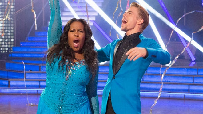 Amber Riley and Derek Hough celebrate Tuesday after winning Season 17 of ABC's 'Dancing With the Stars.'