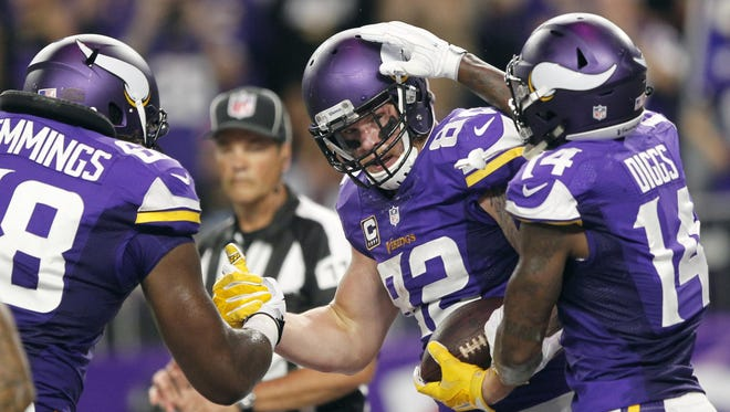 Minnesota Vikings tight end Kyle Rudolph, center, celebrates with teammates T.J. Clemmings, left, and Stefon Diggs, right, after catching a 7-yard touchdown pass Monday against the New York Giants in Minneapolis.