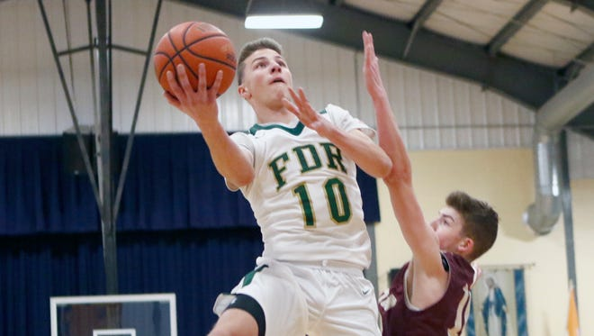 FDR's Ethan Hart (10) drives to the basket against Arlington in the consolation game of the Duane Davis memorial basketball tournament at Our Lady of Lourdes High School in Poughkeepsie on Saturday, December 31, 2016.
