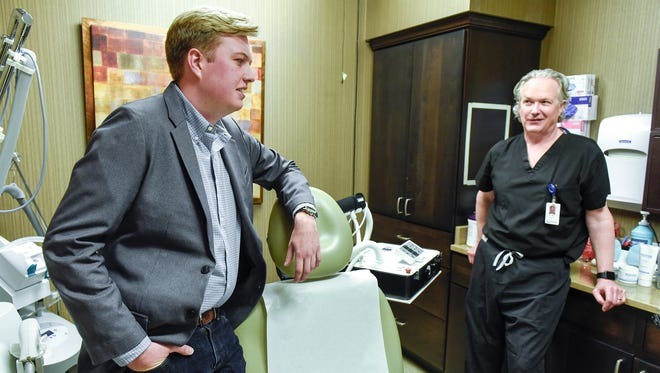 Sam LaBine and his father Dr. Barry LaBine talk about the business model of Refine Acne Clinics Monday, May 21, located at 2251 Connecticut Ave. S in Sartell. Clients submit their information and photos to fast-track a custom acne treatment plan.