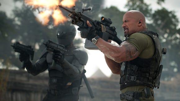 "Snake-Eyes (Ray Park, left) and Roadblock (Dwayne Johnson) battle Cobra bad guys in ""G.I. Joe: Retaliation."""
