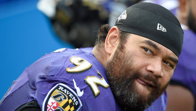 In this Nov. 9, 2014, file photo, Baltimore Ravens defensive end Haloti Ngata watches the action from the sidelines during the second half of an NFL football game against the Tennessee Titans in Baltimore.
