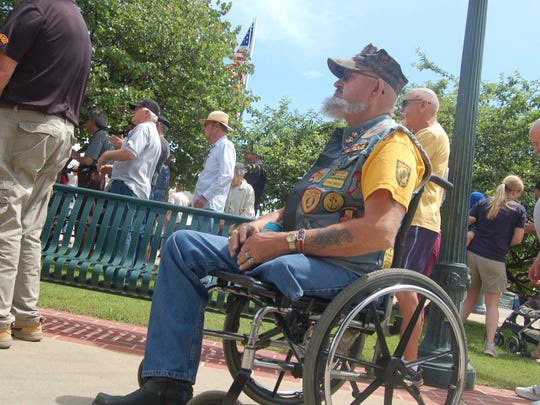 """Gerald """"Butch"""" Wesley listens to a speech during a Memorial Day event at Mountain Home Plaza Monday. He lost his left foot in the Vietnam War."""