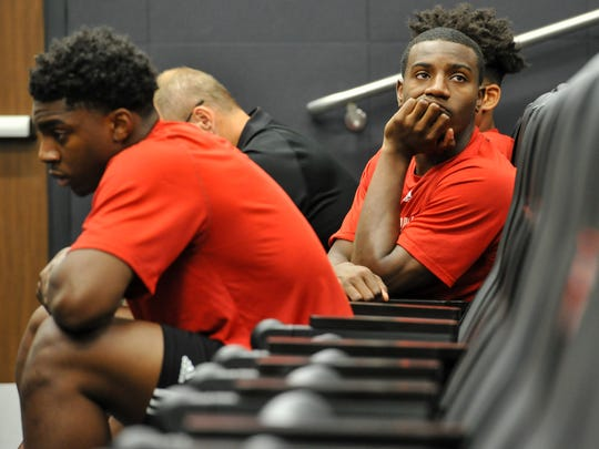 UL guard Johnathan Stove, right, collects his thoughts during Tuesday's press conference to discuss the tragic death of Cajun teammate Herman Williams.