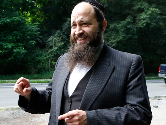 Community liaison Rabbi Yisroel Kahan explains the